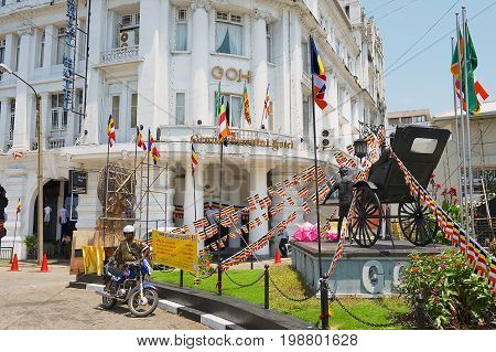 COLOMBO, SRI LANKA - MAY 17, 2011: Entrance to the Grand Oriental Hotel luxury colonial building at York Street with the rickshaw monument in front of it in Colombo, Sri Lanka.