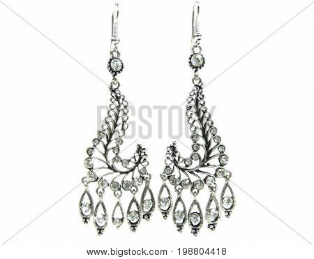 jewelry earrings with white crystals isolated on white background