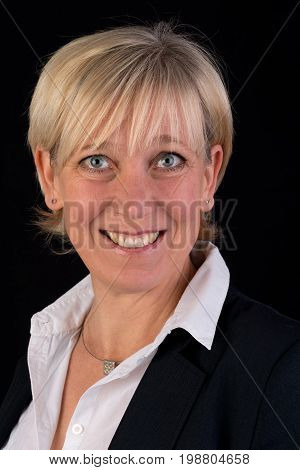 beautiful caucasian mature woman in business suite, headshot - photograph on black background