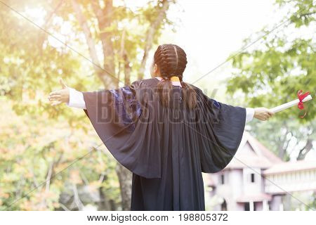 Happy and glad graduated Asian student girl standing and showing hand congratulations graduate education success concept education and finished learning in class