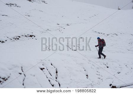 Man Traveler Climbs To The Mountain Pass
