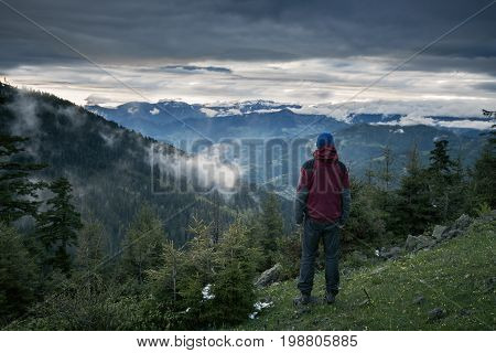 Meditating Adventurer Admiring Epic View Of The Mountains