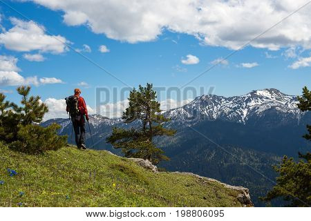 Man Traveler Stands On The Edge Of The Cliff