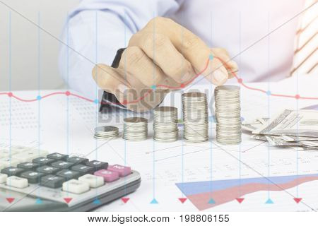 Saving money concept preset by Male hand putting money coin stack growing business concept in grow and walk step by step for success