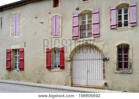 Stone façade of france with shutters of burgundy color in the city of Bar le Duc in Meuse Française