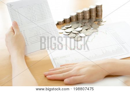Stack of coins with Passbook, book banking