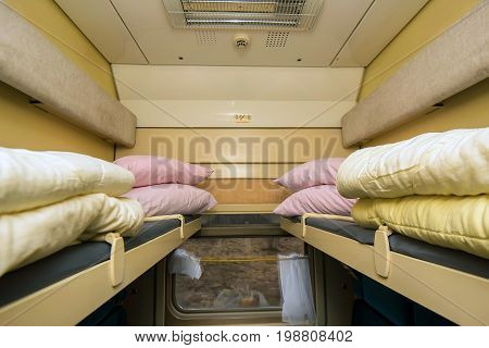 Empty interior of modern train compartment with comfortable soft blue seats