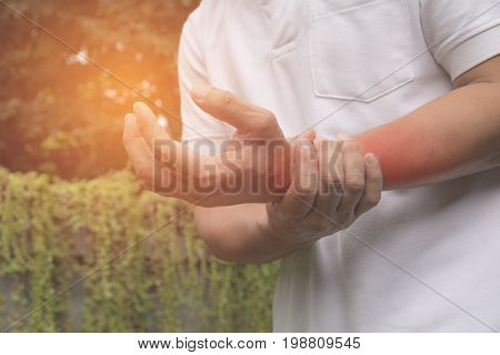 Man holding his wrist. Pain in a man wrist. Man massaging painful wrist. pain concept.