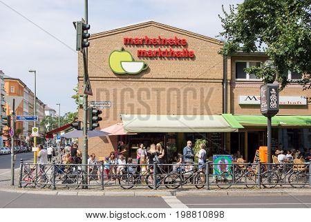 BERLIN GERMANY - JULY 9 2017: Tourists In Front of Marheineke Markthalle Market In Berlin-Kreuzberg