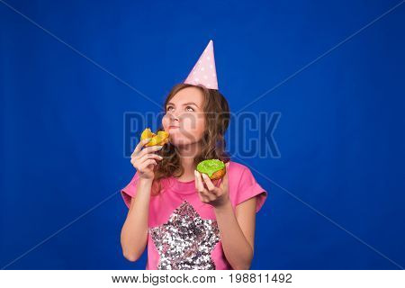 Young beautiful woman with doughnut on yellow background