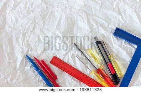 tools for handmade and craft on white crumpled paper background