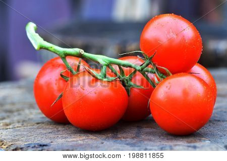 Ripe Tasty Red Tomatoes. Village Market Organic Tomatoes. Fresh Tomatoes. Qualitative Background Fro