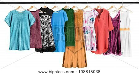 Group of dresses hanging on clothes racks isolated over white
