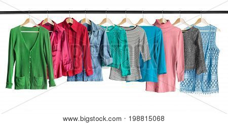 Group of shirts hanging on clothes racks isolated over white