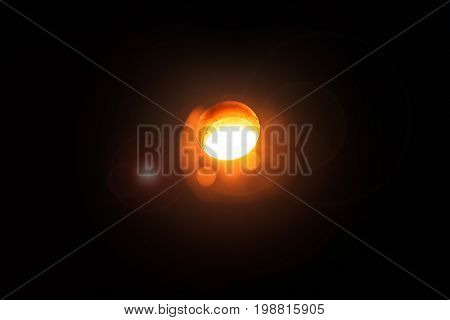 Orange molten steel. Hard work in the aluminum foundry. Steel factory. Melting furnace on a black background. Metallurgical business. Production of steel. Copy space.