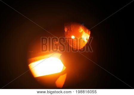 Hard work in the aluminium foundry. Steel factory. Orange molten steel. Melting furnace on a black background.  Metallurgical business. Production of steel. Copy space.