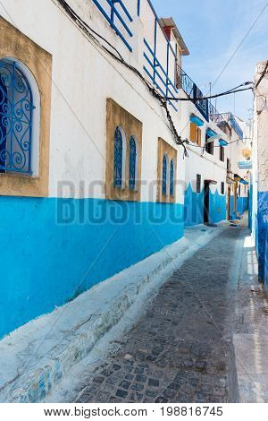 Famous blue and white houses at the Kasbah of the Udayas in Rabat Morocco a UNESCO heritage site.