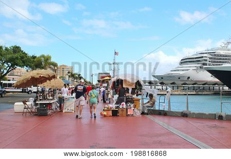 Carnival Conquest cruise ship and passengers - March 9 2017 - cruise ships passengers returning to their ship docked in San Juan Puerto Rico