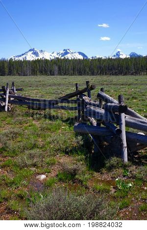 Crooked-Rail Fence surrounds ranch with Idaho's Sawtooth Mountains in the background, near Stanley.