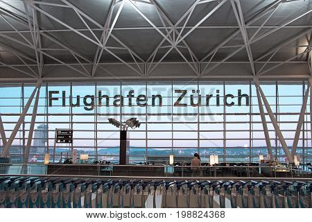 Zurich Switzerland - June 11 2017: Airport Zurich (Flughafen Zurich) waiting area after check-in - view towards airfield with lettering