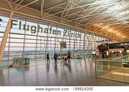 Zurich Switzerland - June 11 2017: Airport Zurich (Flughafen Zurich) waiting area after check-in - view towards airfield
