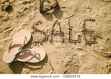 Sale Word written in the sand on a beach