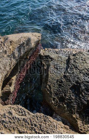 Rocky coastal landscape on the Mediterranean Sea in Majorca in the backlight