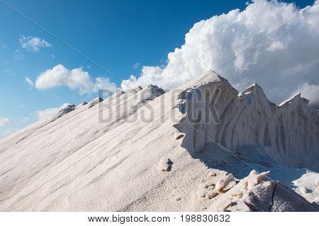 freshly harvested salt mountains before dramatic sky on Majorca