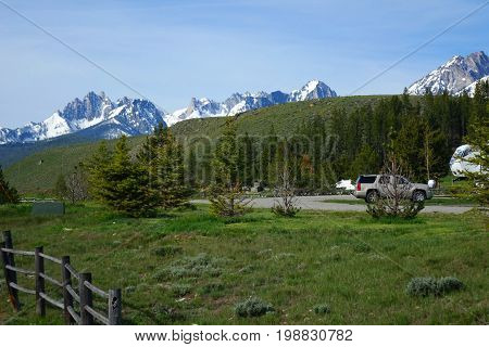 Stanley, Idaho with rugged, snow-covered Sawtooth Mountains in the background.
