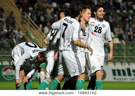 KAPOSVAR, HUNGARY - MAY 8: Gyor players celebrate a goal at a Hungarian National Championship soccer game Kaposvar vs. Gyor - May 8, 2010 in Kaposvar, Hungary.