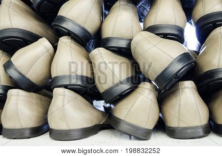 Ready-made pairs of shoes, a stack of shoes at a shoe factory.