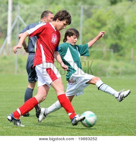 KAPOSVAR, HUNGARY - MAY 9: Adam Kiss (L) and Bence Kiss (R) in action at the Hungarian National Championship under 15 game between Kaposvari Rakoczi and Nagykanizsa May 9, 2010 in Kaposvar, Hungary.