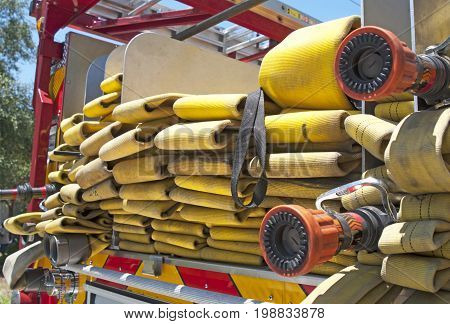 Yellow fire hose on a fire truck, on a sunny morning, Clearwater, Florida, USA.