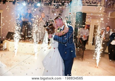 Newly Married Couple Dancing On Their Wedding Party With Heavy Smoke, Multicolored Lights And Firewo