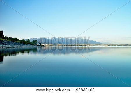 View on level water in dam Liptovska Mara with the background of the Havranok church. Water reservoir on Liptov.