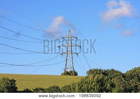 Electricity pylon and cables on a hill