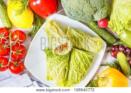 Savoy cabbage wraps with vegetables and shrimp. Love for a healthy vegetarian food concept.
