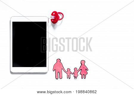 Mockup for adoption concept. Tablet PC on white background top view.