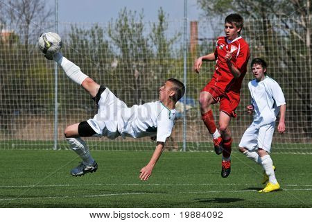 KAPOSVAR, HUNGARY - APRIL 10: Patrik Bojte (L) in action at the Hungarian National Championship under 17 game between Rakoczi FC and Debrecen April 10, 2010 in Kaposvar, Hungary.