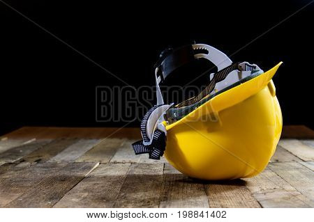 Yellow Helmet On An Old Wooden Table. Workshop In The Workshop. Wooden Table.
