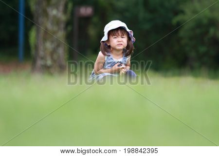 Japanese Girl Crying On The Grass (2 Years Old)