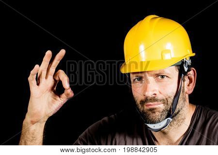 Worker, Employee In A Helmet. Black Beard, Black Background.