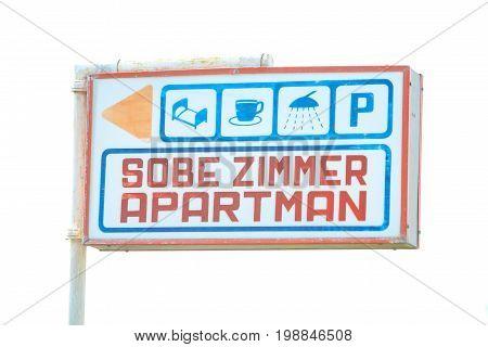 Apartment rental sign in front of house in Njivice Krk Croatia.