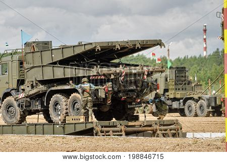 Tyumen, Russia - August 6, 2017: International Army Games. Safe Route contest. Assemblage of the mechanized bridge from TMM set