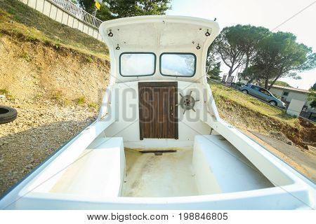 NJIVICE CROATIA - JUNE 24 2017 : A boat parked at a parking lot in Njivice island of Krk Croatia.
