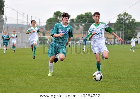 KAPOSVAR, HUNGARY - MAY 29: Attila Kovacs (L) in action at the Hungarian National Championship under 15 game between Kaposvari Rakoczi and Paks May 29, 2010 in Kaposvar, Hungary.