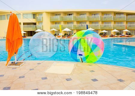 Sharm El Sheikh, Egypt - April 09, 2017: The empty inflatable balloon, having fun on the water at Sharm El Sheikh, Egypt - April 09, 2017. The ball in the water - fascinating summer attractions for children. Water zorbing.