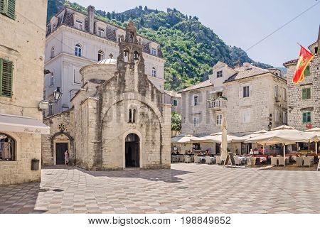 Saint Luke square with the St. Luka's one-nave church built by Mauro Kacafrangi in 1195 example of the Romanesque and Byzantine architecture in the old town of Kotor Montenegro. It is a part of UNESCO's World Heritage Site.