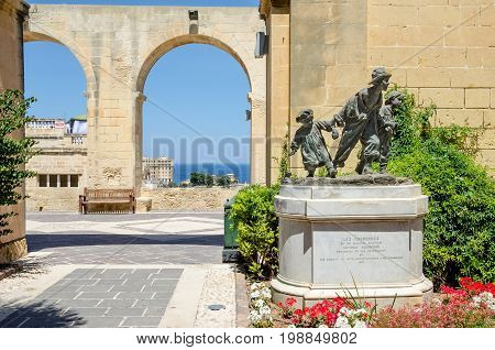 Valletta Malta - June 4 2017: A replica of the statue Les Gavroches (The street boys) by the Maltese sculptor Antonio Sciortino in the Upper Barrakka Gardens a public garden in Valletta Malta.