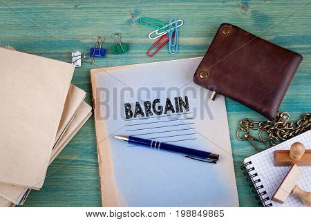 Bargain concept. Notebook on a bright green background. Office stationery accessories.